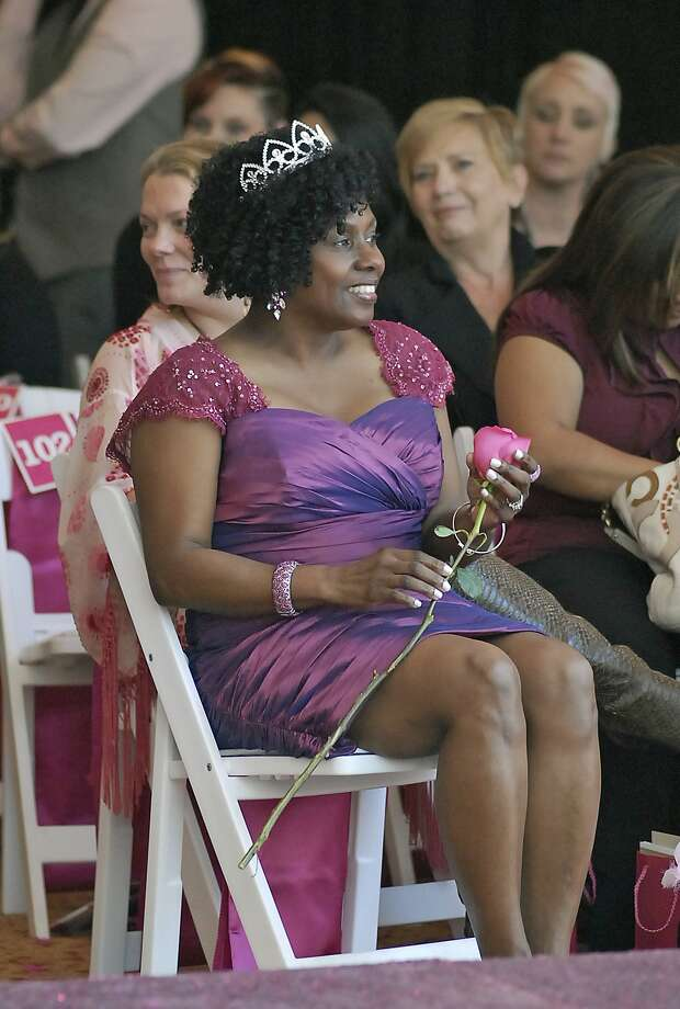 Beverly Outram sits in the audience with a tiara and a rose signifying her defeat of breast cancer during the North Cypress Medical Center Project Pink 2013 event benefiting the Houston affiliate of Susan G. Komen for the Cure on Oct. 19. Photo: © Tony Bullard 2013, Tony Bullard / © Tony Bullard & the Houston Chronicle