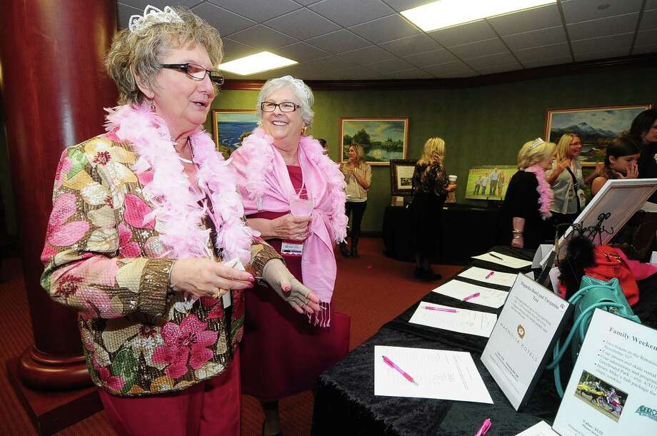Fredna Kilcommins and Linda Densman check out the silent auction items to see if anyone has bid above them during the North Cypress Medical Center Project Pink 2013 event benefiting the Houston affiliate of Susan G. Komen for the Cure  on Oct. 19. Photo: © Tony Bullard 2013, Tony Bullard / © Tony Bullard & the Houston Chronicle