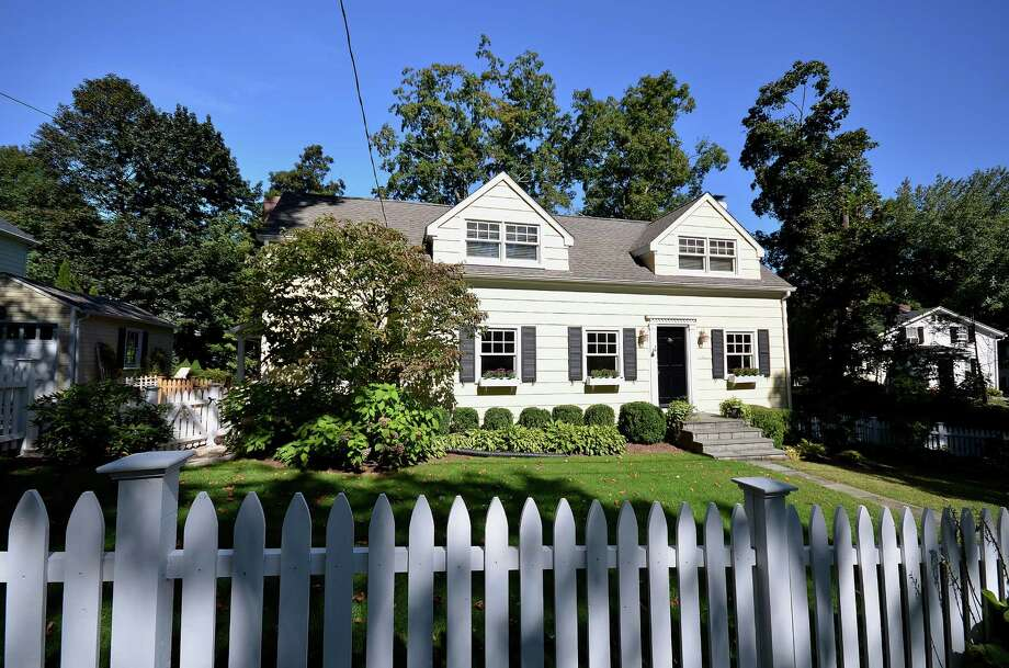 The Cape Cod at 7 Olmstead Court in New Canaan, convenient to town, is placed in an ideal setting on a tiny cul-de-sac and off quiet road. It is on the market for $1,199,000. Photo: Contributed Photo, Contributed / New Canaan News Contributed