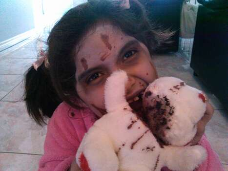 This is my 8 yr. old daughter Anahi as a CHILD ZOMBIE in pajamas!!!! Poor Teddy was her 1st victim!!!!