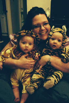 Whitney Williamson and her seven month old twin girls! Carsyn is the lion and Hadley is the tiger! Lions and tigers and mommy, OH MY!