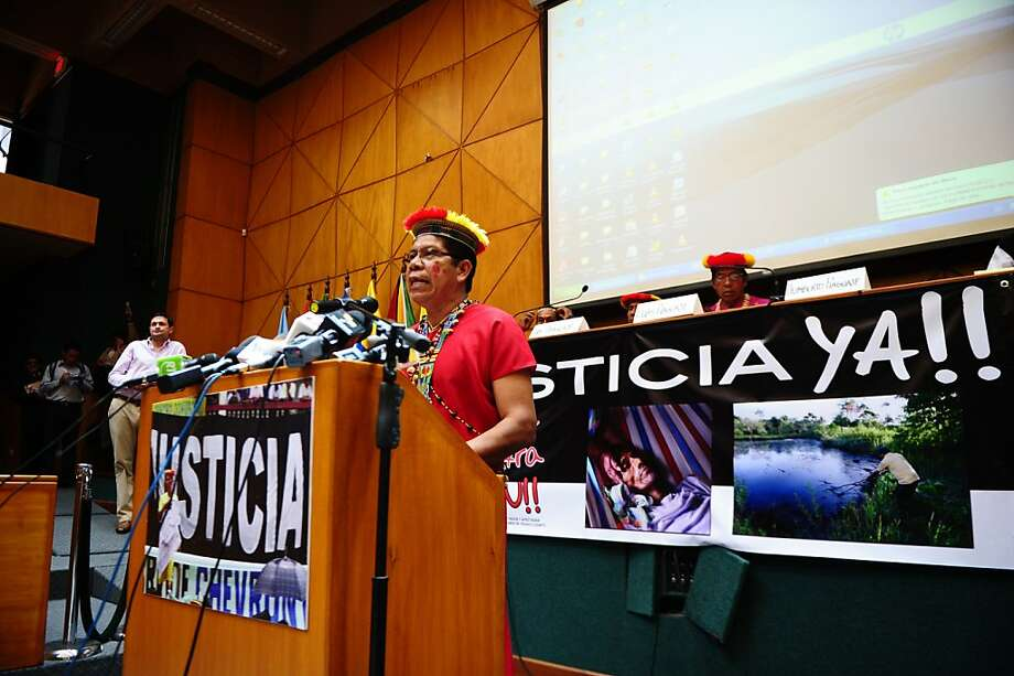 Humberto Piaguaje, who represents the villagers who sued Chevron over pollution in the Ecuadoran Amazon, speaks at a news conference in Quito. Photo: Rodrigo Buendia, AFP/Getty Images