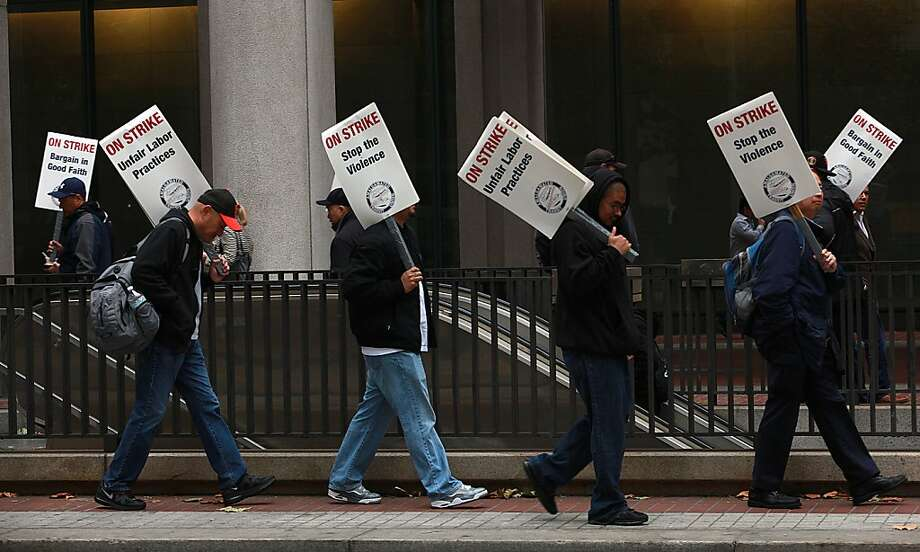 Members of the Amalgamated Transit Union walk the picket line past the Embarcadero BART Station in San Francisco during the union walkout in October. Photo: Liz Hafalia, The Chronicle