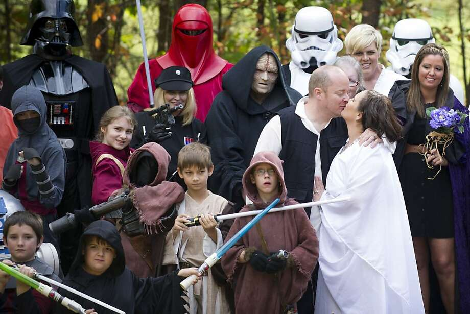 The force is strong in these two:Russell Lynn Ellis and Paloma Mota kiss while posing for photographs at their Star Wars-themed wedding in Pigeon Forge, Tenn. Photo: Saul Young, Associated Press