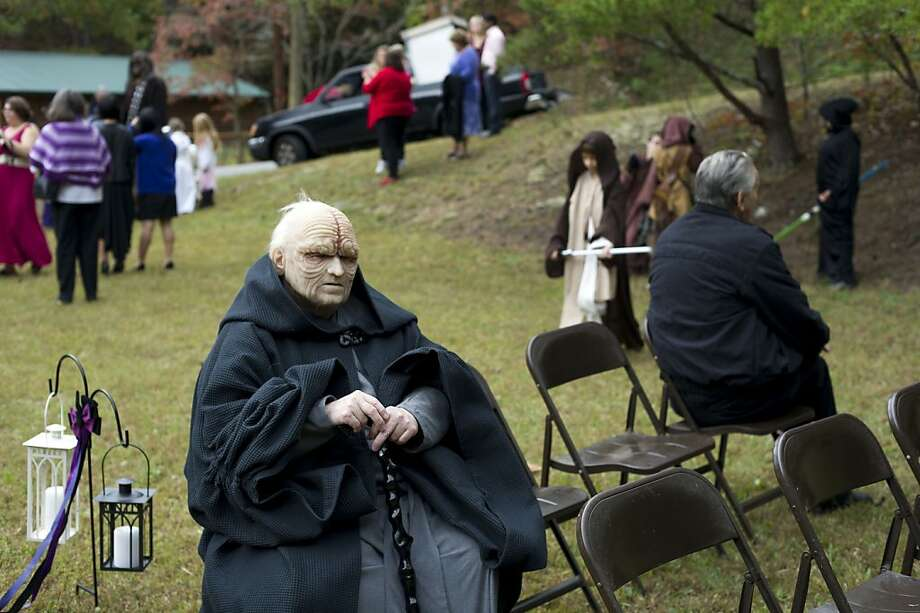 He's from the Dark Side of the family: Predictably, no one wants to sit next to Emperor Palpatine during the ceremony. (Pigeon Forge, Tenn.) Photo: Saul Young, Associated Press