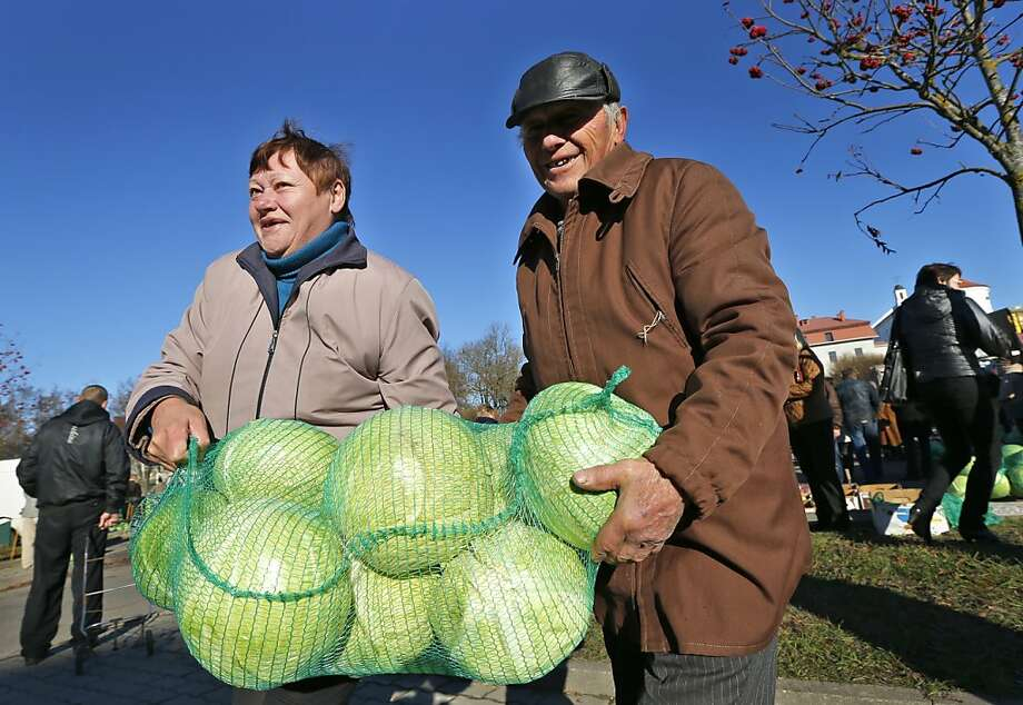 Bargain hunters can get killer deals on cabbage at the street market in Novogrudok, 