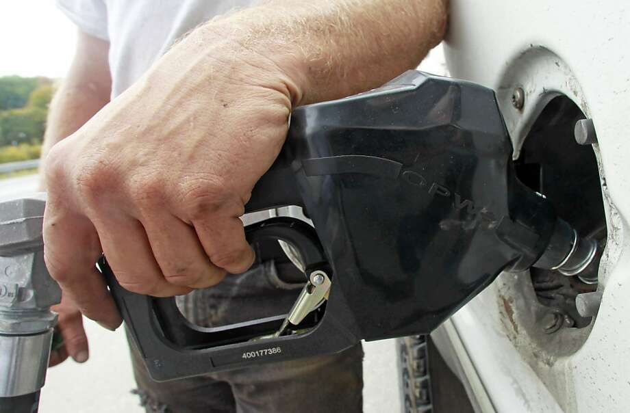The annual average price of gas in 2013 is expected to be $3.52 per gallon, 11 cents lower than in 2012. Photo: Toby Talbot, Associated Press
