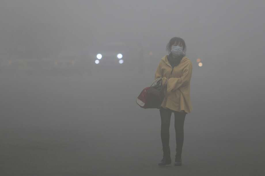 This photo was NOT taken at night: The air pollution is so bad in Haerbin, northeast China, that visibility is 