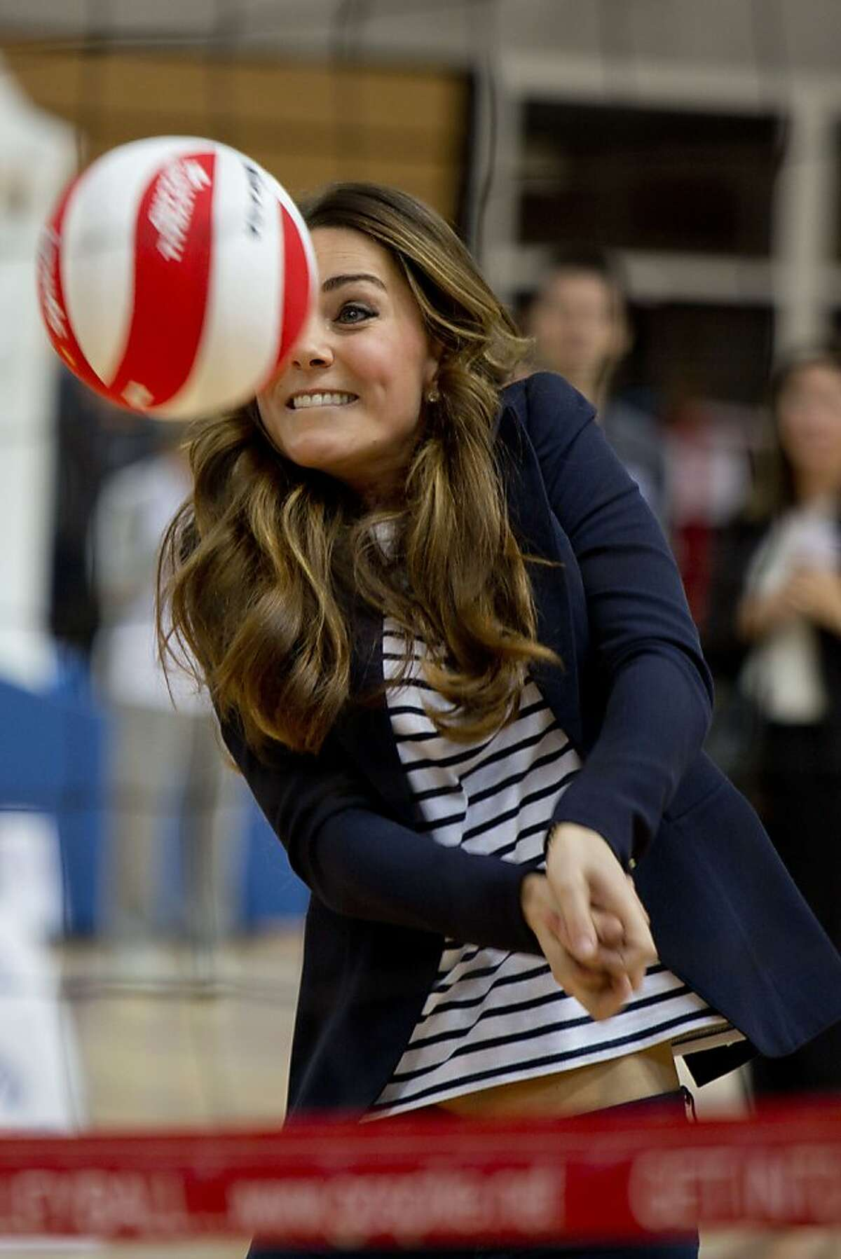 Forearm bump : Kate sets the ball for a teammate's spike during a volleyball match at the SportsAid Athlete Workshop at Queen Elizabeth Olympic Park in London.
