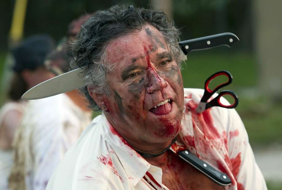 In a hurry to sharpen your knives and scissors? Slow down! Or you'll end up like this guy at the Zombie Bike Ride in Key West, Fla. Photo: Rob O'Neal, Associated Press