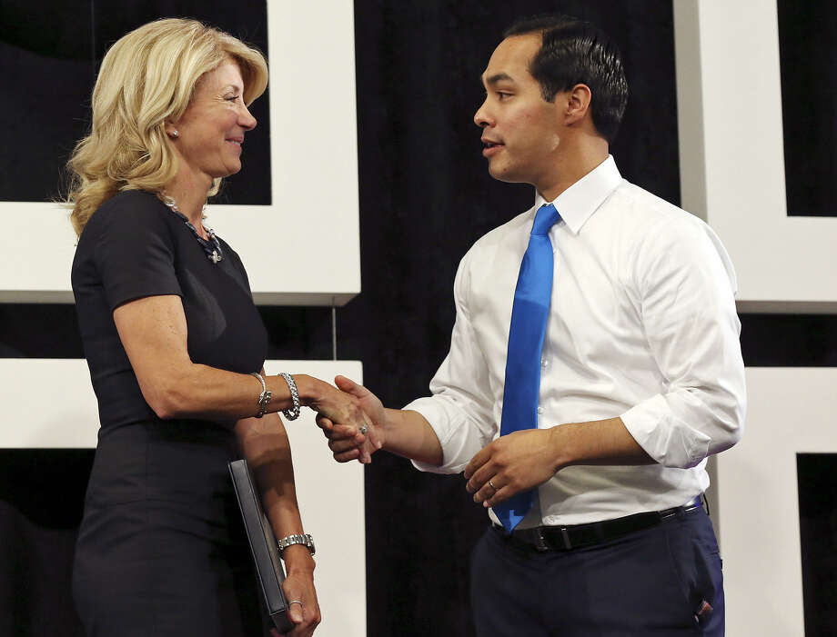 A reader criticizes the Express-News for running so many articles and photos on state Sen. Wendy Davis, shown here with Mayor Julián Castro after speaking during a tour of Rackspace Hosting Inc. Photo: Edward A. Ornelas / San Antonio Express-News