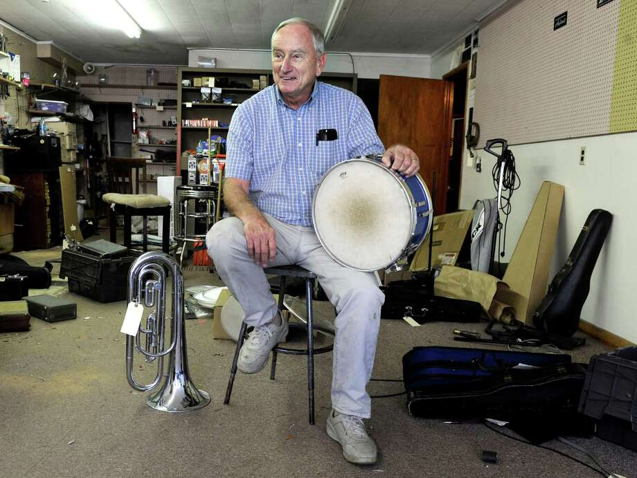 Jim Clark has owned Kanes Music Store & Studio on Granville Ave. in Danbury, Conn., for over 30 years. This week he is clearing out the store and retiring. Photo: Carol Kaliff / The News-Times