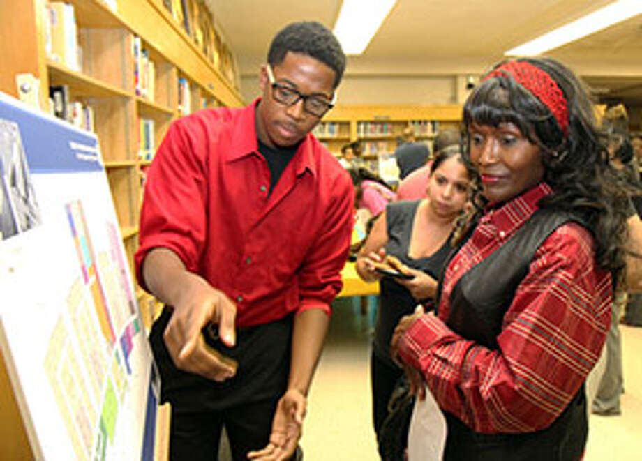A student at Booker T. Washington High School explains a design schematic for the new school. Photo: Provided By Houston Independent School District