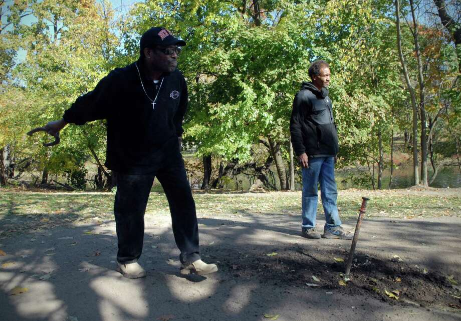 Howard Williams and William Andrew Cooper play horseshoes on Greenwich Ave by the Mill River in Stamford, Conn. on Monday October 21, 2013. Photo: Dru Nadler / Stamford Advocate Freelance