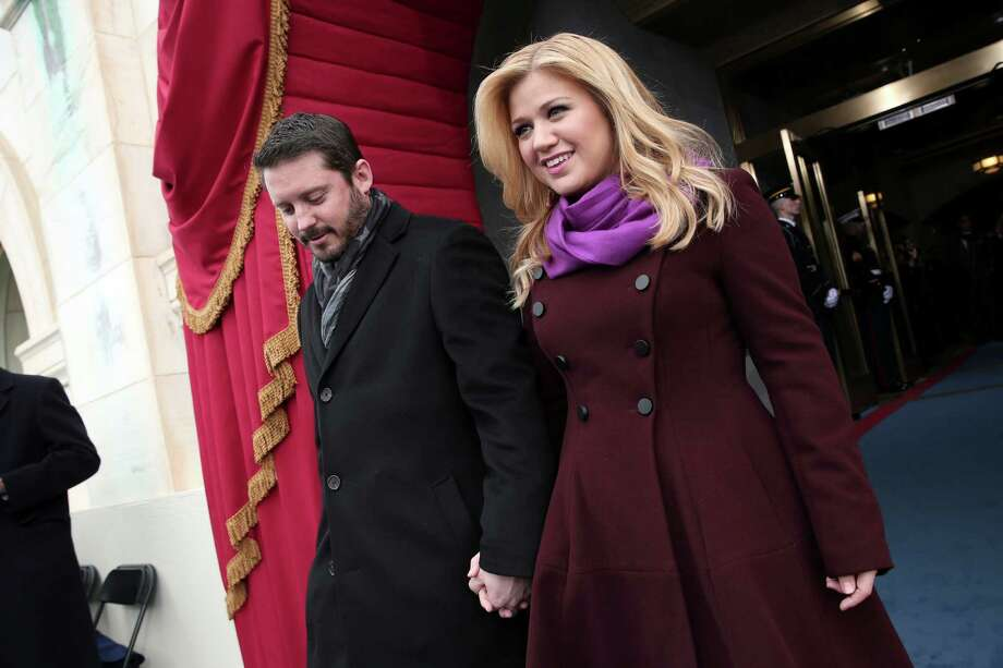 "FILE - In this Monday, Jan. 21, 2013 photo, singer Kelly Clarkson and Brandon Blackstock arrive on the West Front of the Capitol in Washington, for President Barack Obama's ceremonial swearing-in ceremony during the 57th Presidential Inauguration. Clarkson and her music manager Blackstock have gotten married. Clarkson tweeted a photo Monday, Oct. 21, 2013, in her wedding gown next to Blackstock. She wrote: ""I'm officially Mrs. Blackstock."" (AP Photo/Win McNamee, Pool, File) ORG XMIT: NY113 Photo: Win McNamee / Pool Getty Images North America"