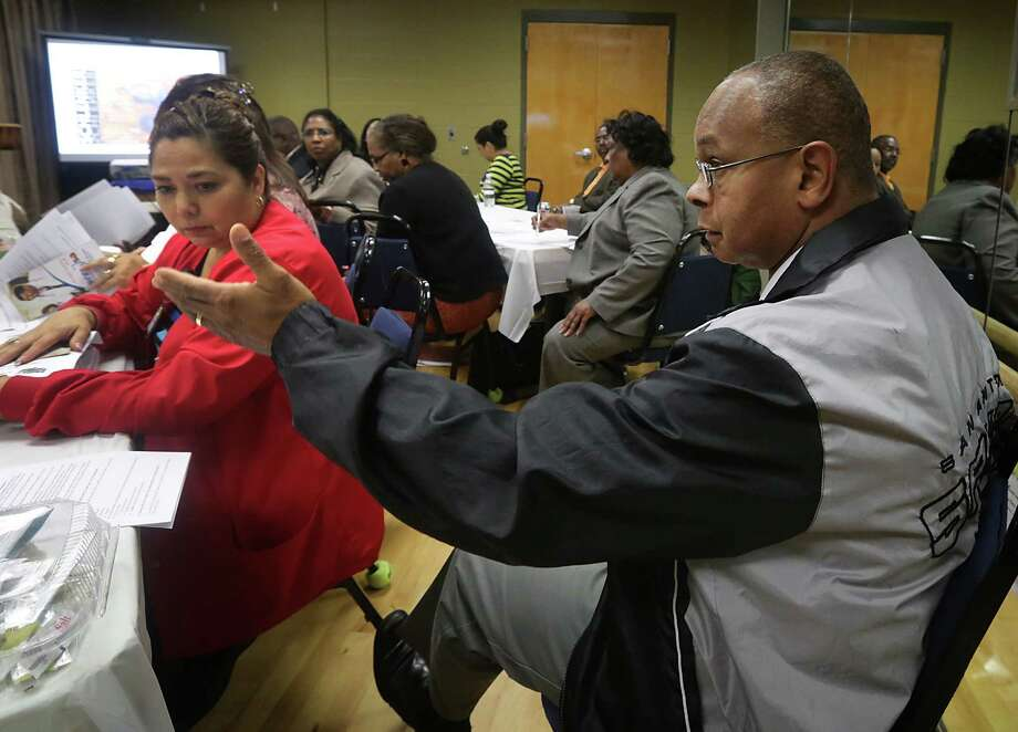 Dr. Loren Alves, left, makes a point as physicians and community activists meet at Antioch Baptist Church, Wednesday, Oct. 16, 2013, to discuss the upcoming Affordable Care Act and also if funds from a federal Choice Neighborhood grant can be used to bring a more advanced health care facility to San Antonio's East Side. Photo: BOB OWEN, San Antonio Express-News / © 2012 San Antonio Express-News