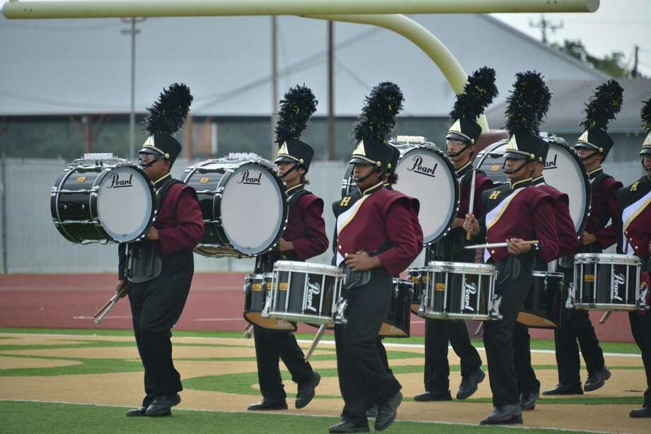 The Harlandale High School band's drum line marches onto the field, playing for an enthusiastic crowd at the recent Harlandale Band Festival. Nearly two dozen bands participated in the annual event at Memorial Stadium. Photo: Courtesy