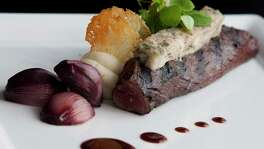 A Hanger Steak Bordelaise is photographed at Kris Bistro and Wine Lounge.