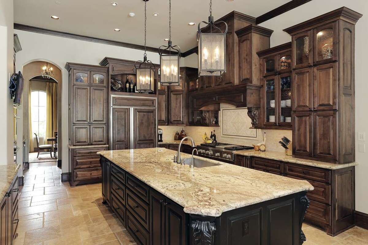 Custom wood cabinetry with granite countertops highlight the kitchen.