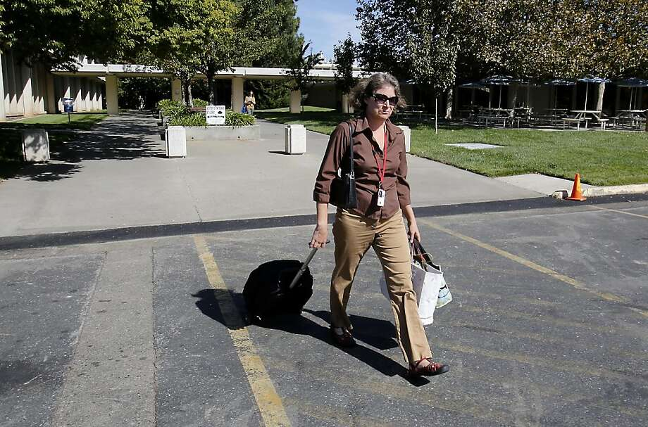 Bronwyn Hogan leaves the U.S. Fish and Wildlife Service offices in Sacramento after she was furloughed. Photo: Rich Pedroncelli, Associated Press