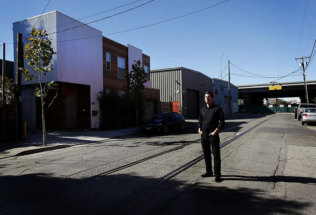 Architect Matthew Baran is photographed in front of the Bordertown home (at left) he designed in the Dogtown neighborhood of Oakland, Calif., on Thursday, October 3, 2013.