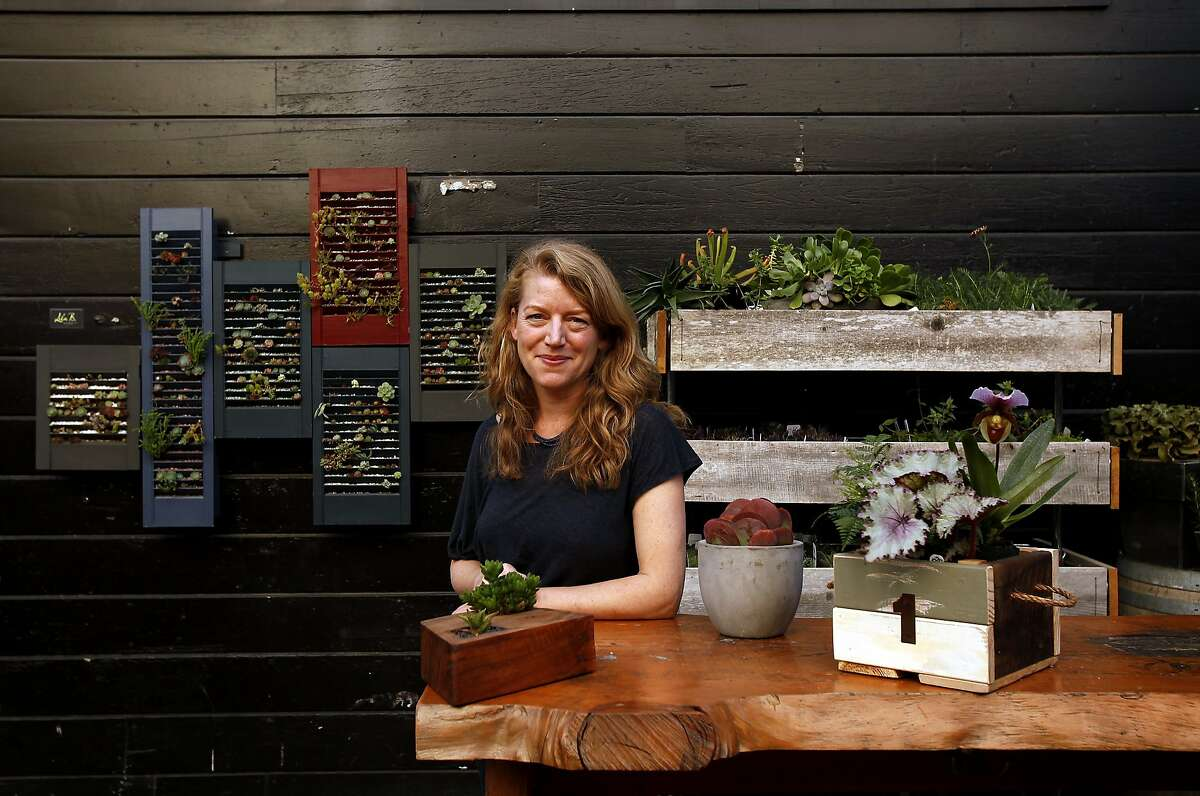 Baylor Chapman, owner of the Lila B. Design center, is photographed at their new location in the courtyard of Stable Cafe in San Francisco, Calif., on Wednesday, October 16, 2013.