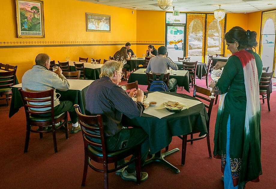 People have lunch at Tandoor Restaurant in Pinole, run by an experienced restaurateur and experienced chef. Dishes include chicken tikka kabob, left, and chicken achari, below. Photo: John Storey, Special To The Chronicle