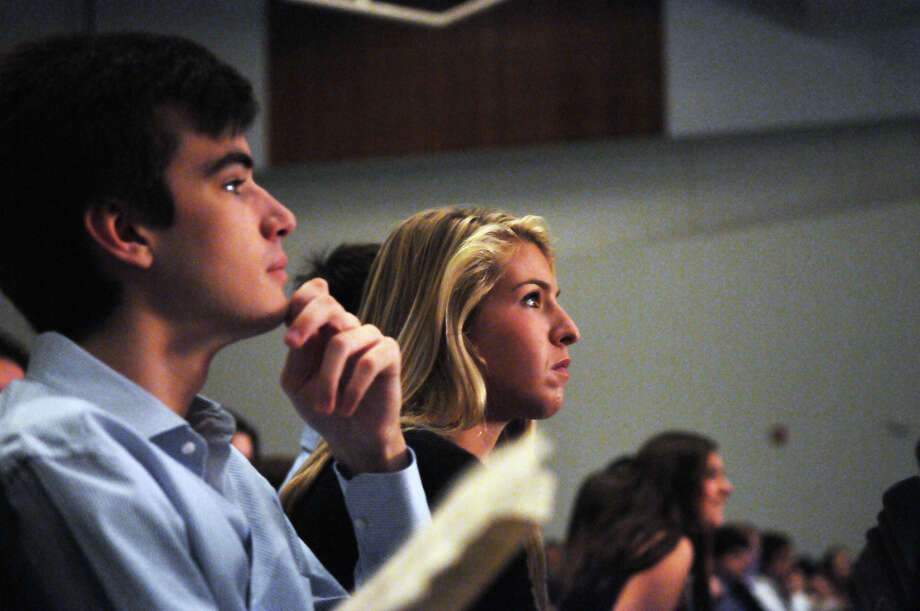Inductees Taylor Brimberg, right, and James Brett watch the ceremony as Greenwich High School holds its National Honor Society Induction ceremony in the school's auditorium in Greenwich, Conn., Oct. 21, 2013. Photo: Keelin Daly / Stamford Advocate Freelance