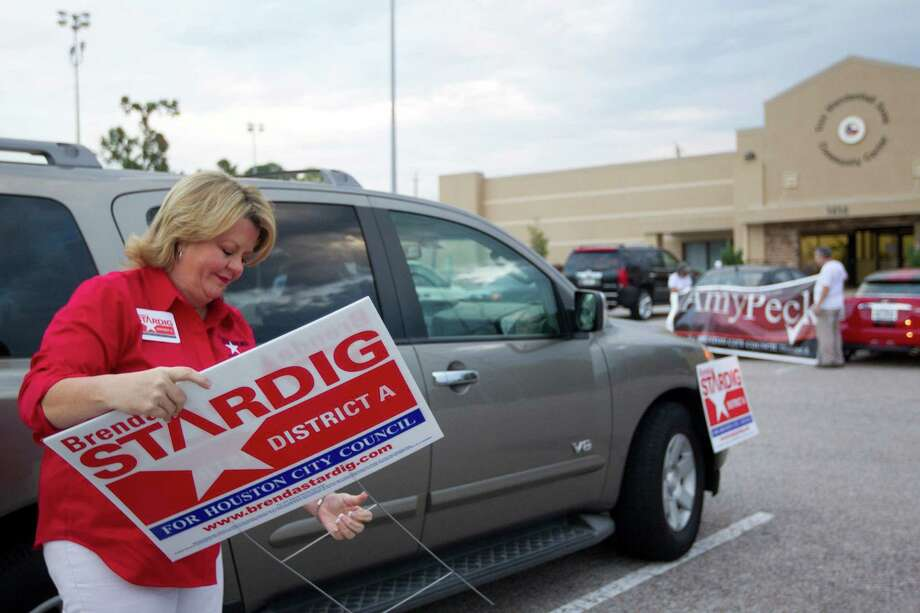 Brenda Stardig, who is running for the Houston City Council District A seat puts out campaign signs outside an early voting site at the Trini Mendenhall Sosa Community Center Monday, Oct. 21, 2013, in Houston. Photo: Johnny Hanson, Houston Chronicle / Houston Chronicle