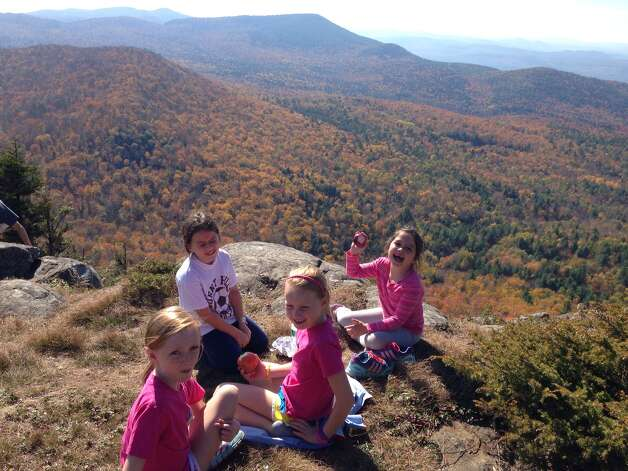 Brad Warner of Burnt Hills said they?d just had a wonderful hike up the Sleeping Beauty Mountain near Lake George on Oct. 13 and the girls ? Natalie and Carly Warner, Isabelle and Charlotte Gable ? were in fine shape, but in need of increasing blood sugar. ?Native New York apples fit the bill! The weather and air and foliage really were picture perfect ... the air was like butter,? he said.  (Brad Warner)