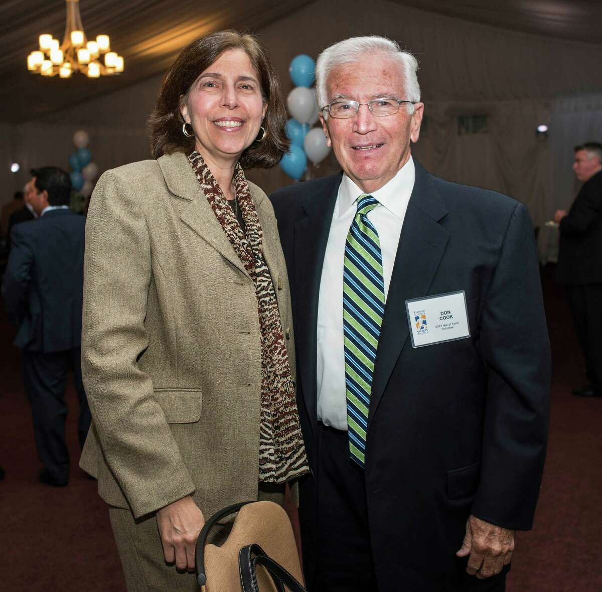 Community service award winner, Don Cook with Janet Canepa at the 9th annual Fairfield County Sports Hall of Fame Sports Night held at the Greenwich Hyatt Regency, Greenwich, CT on Monday, October, 21st, 2013.