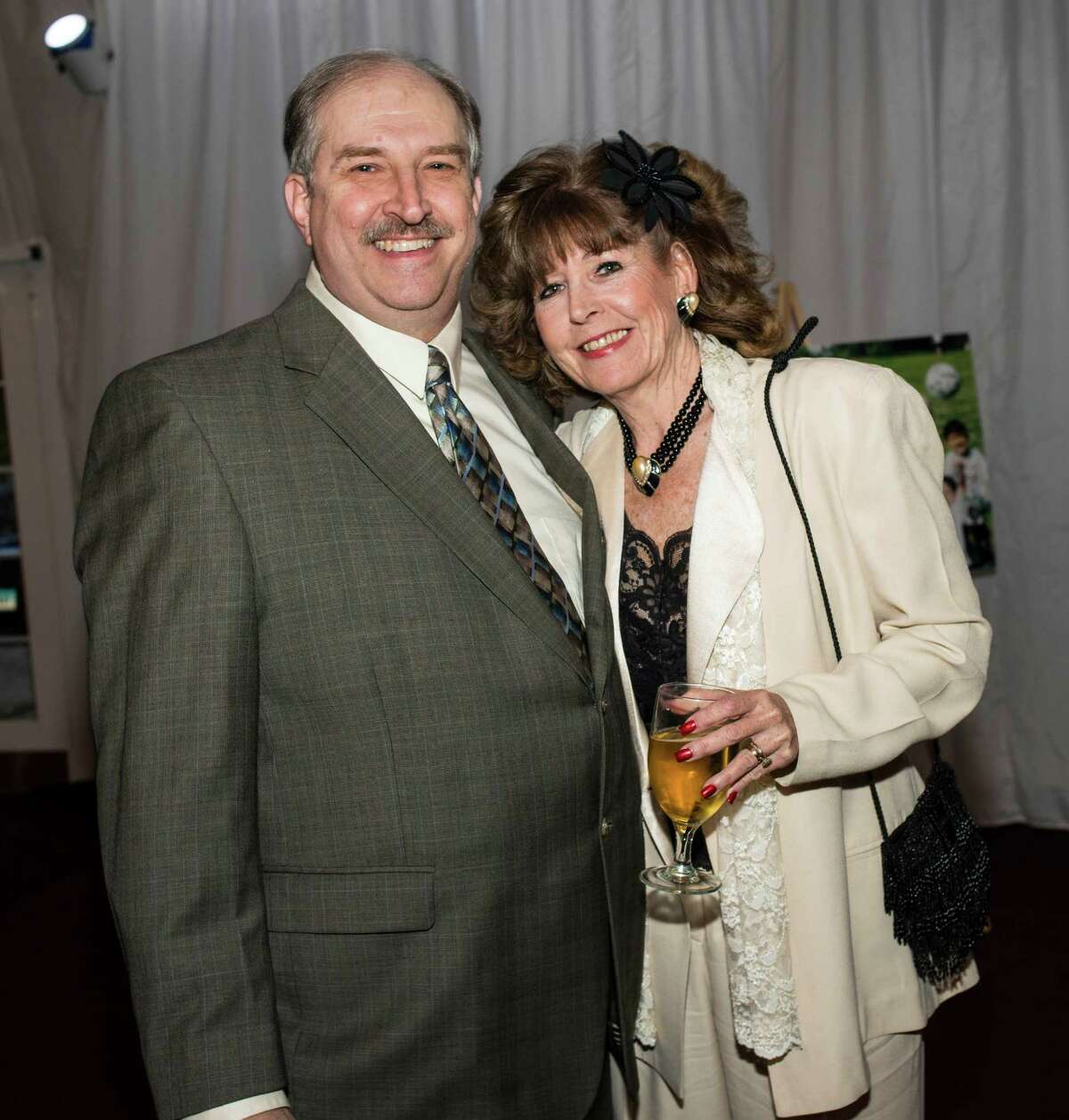 Recipient of the Bill Gonillo Local Sports Media award, Bob Ehalt with his wife Carylanne at the 9th annual Fairfield County Sports Hall of Fame Sports Night held at the Greenwich Hyatt Regency, Greenwich, CT on Monday, October, 21st, 2013.