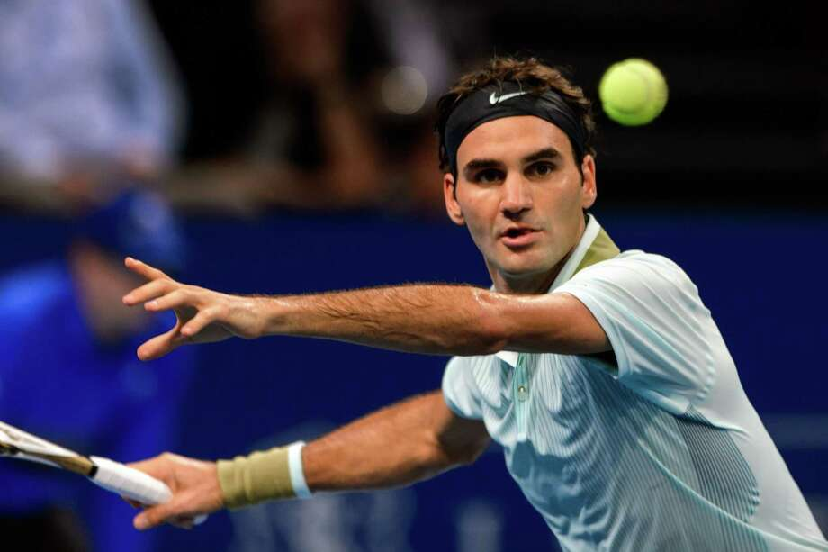 Switzerland's Roger Federer eyes the ball as he returns to France's Adrian Mannarino during their match at the Swiss Indoors ATP tennis tournament on October 21, 2013 in Basel. AFP PHOTO / FABRICE COFFRINIFABRICE COFFRINI/AFP/Getty Images Photo: FABRICE COFFRINI / AFP