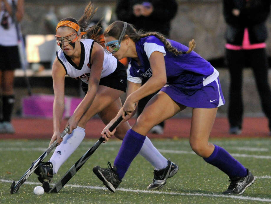 Stamford's Kelly Niesen and Westhill's Lindsey Audrulevich compete for control of the ball during their game at Stamford High School on Monday, Oct. 21, 2013. Westhill won, 3-0. Photo: Jason Rearick / Stamford Advocate
