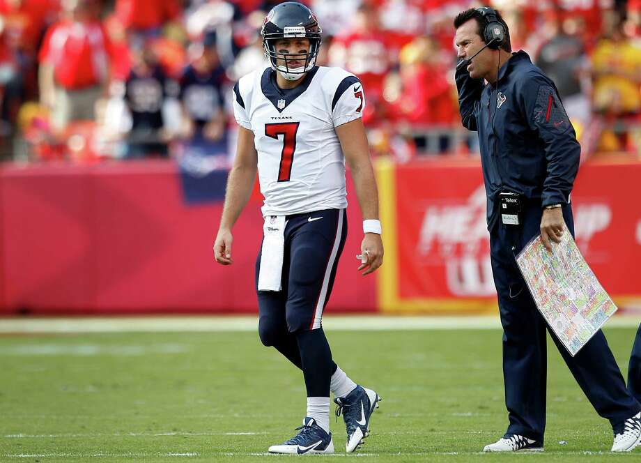 Coach Gary Kubiak, right, praised quarterback Case Keenum (7) for his performance in the Texans' loss to the Chiefs but said he needs time to evaluate the QB. Photo: Brett Coomer, Staff / © 2013  Houston Chronicle