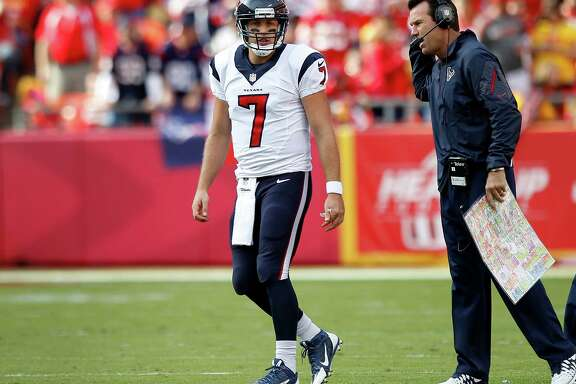Coach Gary Kubiak, right, praised quarterback Case Keenum (7) for his performance in the Texans' loss to the Chiefs but said he needs time to evaluate the QB.