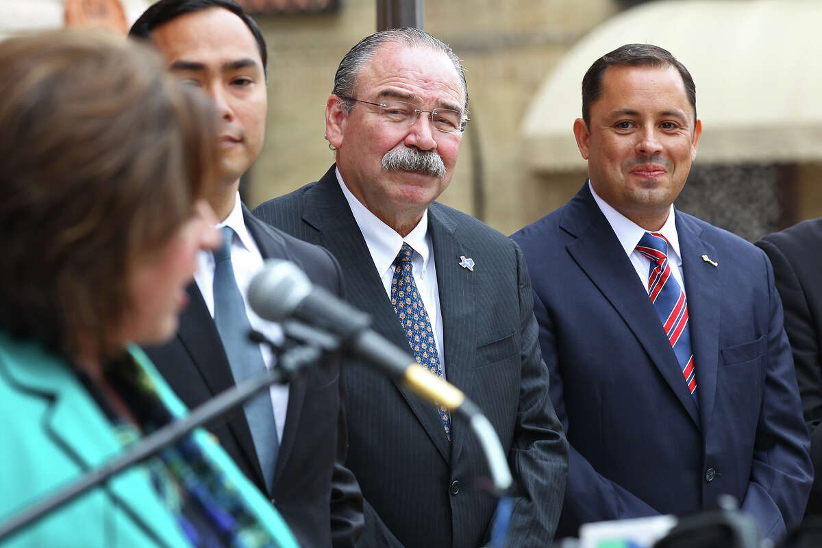 Bexar County Court-at-Law No. 11 Judge Carlo Key, right, smiles as Texas Sen. Leticia Van de Putte, left, welcomes him to the Democratic Party during a press conference in front of the Bexar County Courthouse, Monday, Oct. 21, 2013. Also joining Key are U.S. Rep. Joaquin Castro, center left, and Texas Democratic Chairman Gilberto Hinojosa. The former republican judge switched parties saying that he didn't leave the Republican Party, the party left him.