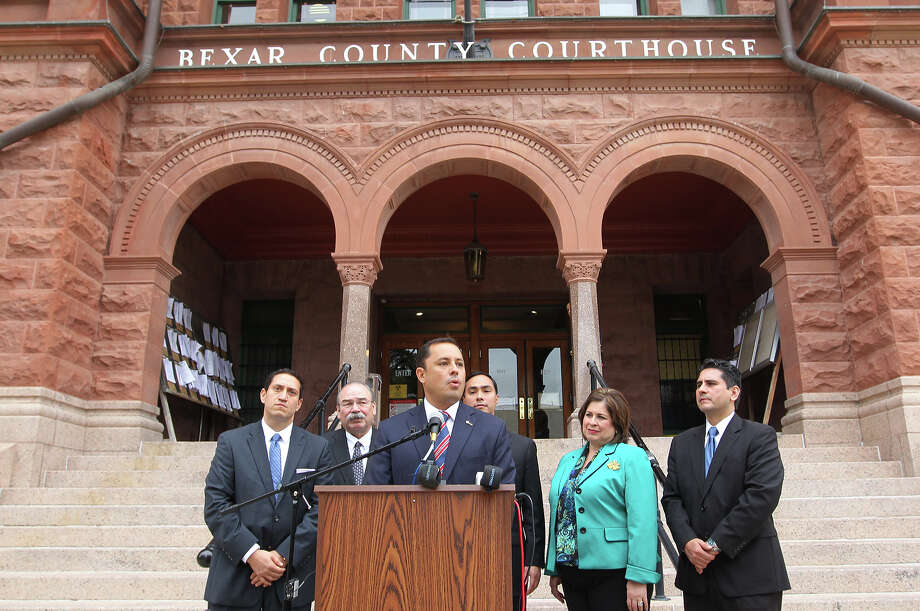 County Court-at-Law No. 11 Judge Carlo Key, at podium, announces on Monday that he switched from the Republican to the Democratic Party. Photo: JERRY LARA, San Antonio Express-News / © 2013 San Antonio Express-News