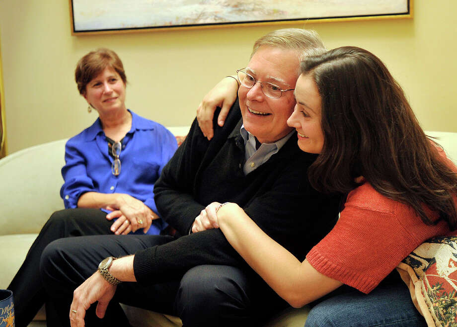 Democratic mayoral candidate David Martin and his daughter, Sarah, embrace as his wife, Judy, looks on while speaking to a reporter at their home in north Stamford on Monday, Oct. 21, 2013. Photo: Jason Rearick / Stamford Advocate
