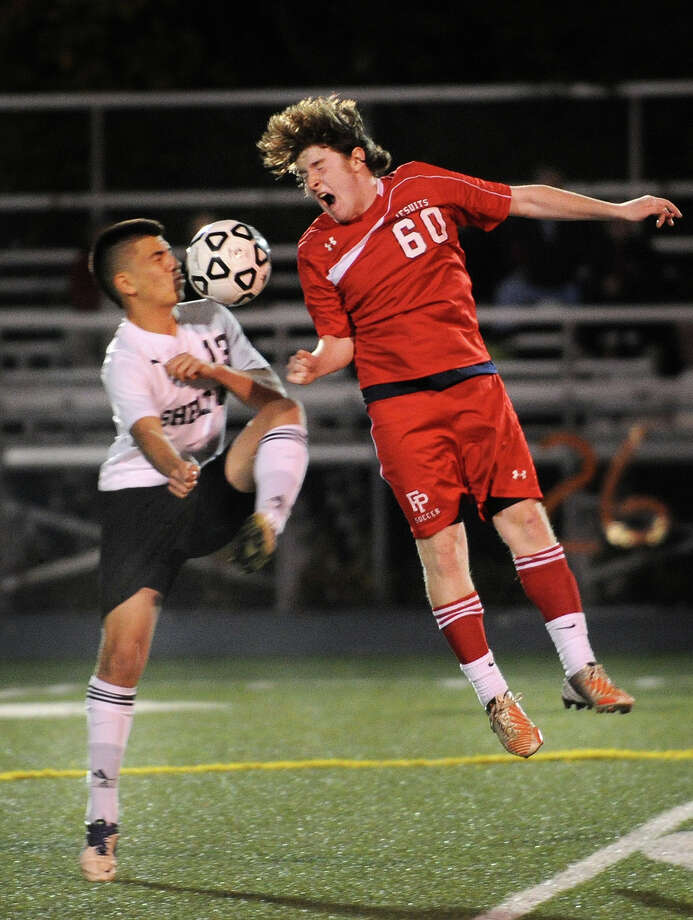 Shelton's Brian Chilet, left, converges on a ball with Fairfield Prep's Pat Hess during the first half of their boys soccer matchup at Shelton High School in Shelton, Conn. on Monday, October 21, 2013. Photo: Brian A. Pounds / Connecticut Post