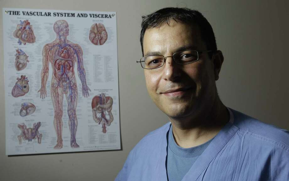 Dr. Hosam El-Sayed, an endovascular surgeon at a Houston medical center, saves limbs by using a fairly new plaque-clearing technique. Known as retrograde access, it provides a secondary, more delicate path through blockages in limbs. Photo: Melissa Phillip / Houston Chronicle