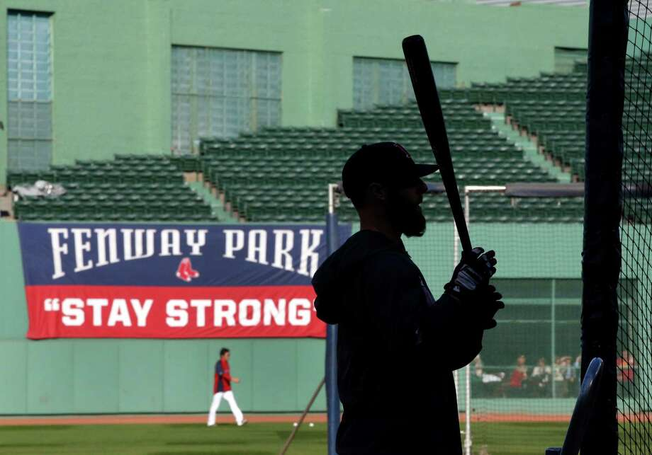 Boston Red Sox's Dustin Pedroia waits for his turn in the batting cage during team baseball practice at Fenway Park in Boston, Monday, Oct. 21, 2013. The Red Sox will face the St. Louis Cardinals in Game 1 of the World Series on Wednesday. (AP Photo/Elise Amendola) ORG XMIT: MAEA110 Photo: Elise Amendola / AP