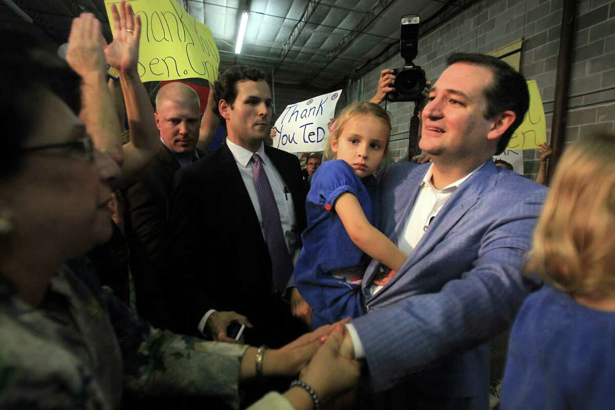 Senator Ted Cruz arrives to his Welcome Home event where a crowd cheers him on at King Street Patriots on Monday, Oct. 21, 2013, in Houston.