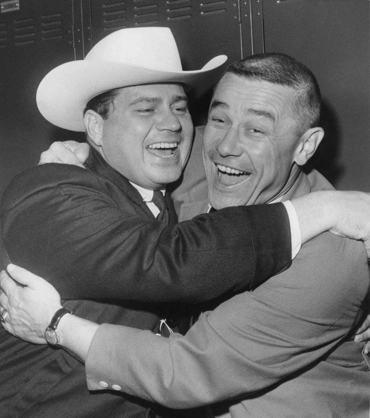 Bud Adams, left, celebrates the Oilers' second AFL title in a row with coach Wally Lemm after the team beat the Chargers 10-3 in San Diego on Dec. 24, 1961.