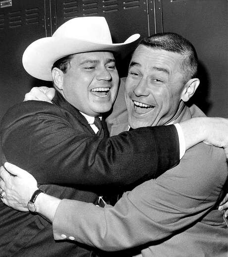 Oilers owner Bud Adams (left) hugs coach Wally Lemm after Houston defeated San Diego for the AFL title Dec. 24, 1961. Photo: Associated Press File Photo / San Diego Union-Tribune
