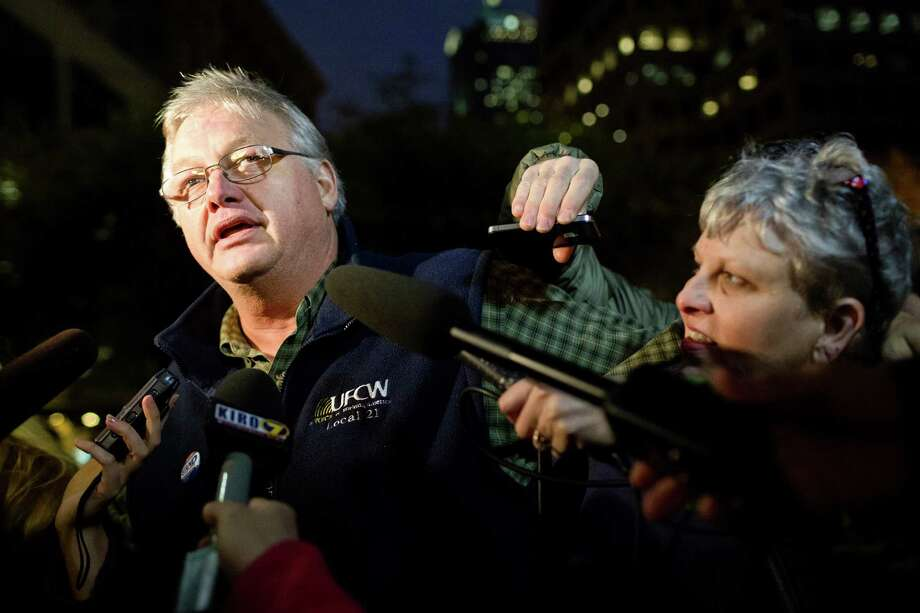 Amidst a crowd of onlookers, UFCW 21 Union President Dave Schmitz, left, speaks to media during a celebration following the cancellation of a grocery strike by way of a tentative deal to keep grocery workers on the job Monday, Oct. 21, 2013, in Westlake Park in downtown Seattle. Employees will vote on the details in coming days. Photo: JORDAN STEAD, SEATTLEPI.COM / SEATTLEPI.COM