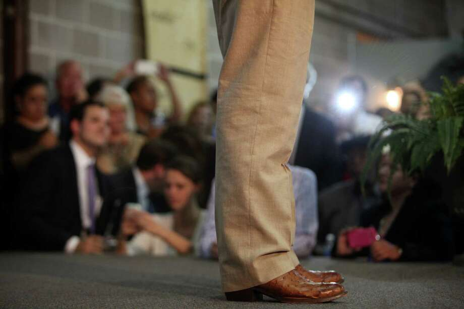Senator Ted Cruz wears cowboy boots to his Welcome Home event at King Street Patriots on Monday, Oct. 21, 2013, in Houston. Photo: Mayra Beltran, Houston Chronicle / © 2013 Houston Chronicle
