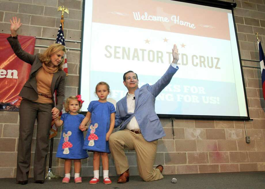 Cruz, his wife, Heidi, and daughters Catherine and Caroline greet the crowd. Photo: Mayra Beltran, Houston Chronicle / © 2013 Houston Chronicle