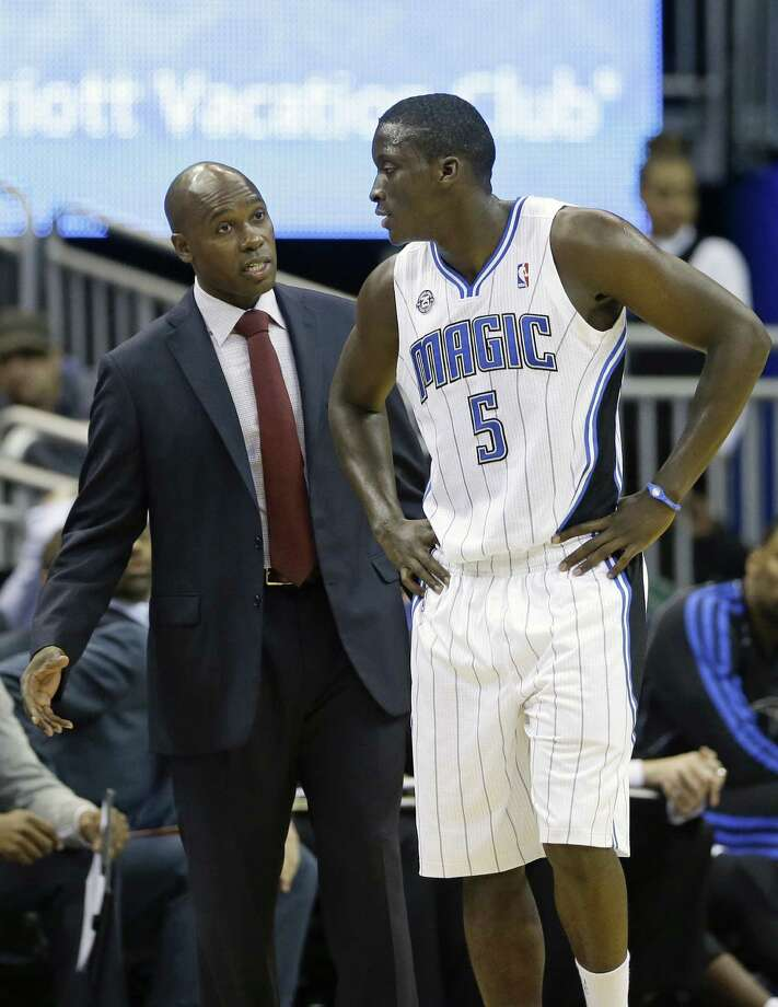 Magic rookie Victor Oladipo (right) can expect afternoon shootarounds with coach Jacque Vaughn. Photo: John Raoux / Associated Press