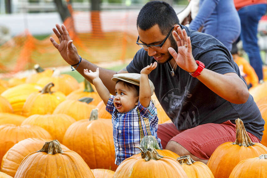 Eleven-month-old Tito De Leon poses for a photo with his father, Pedro De Leon at the University United Methodist Church Pumpkin Patch, 5084 De Zavala Road. The patch is open daily from 9 a.m.-8:30 p.m., through Oct. 31. Visit the site.